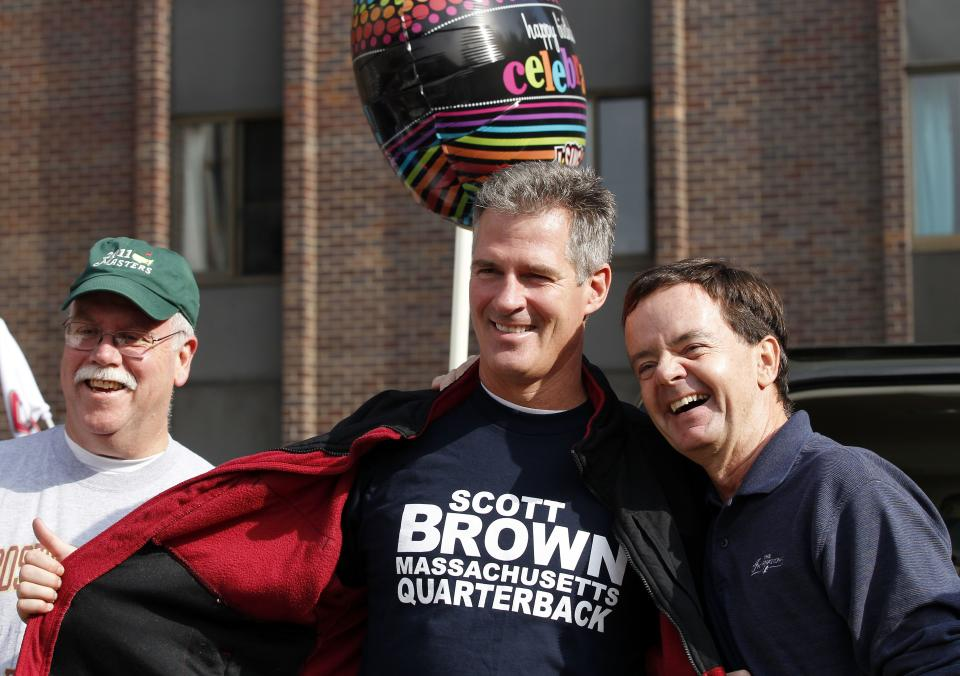Sen. Scott Brown, R-Mass., center, campaigns with tailgaters outside Alumni Stadium before an NCAA college football game between Boston College and Maryland in Boston, Saturday, Oct. 27, 2012. (AP Photo/Michael Dwyer)