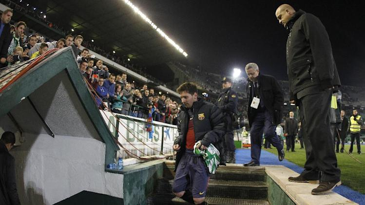 Barcelona's Lionel Messi from Argentina leaves the pitch at the end of their match against Betis during their La Liga soccer match at the Benito Villamarin stadium, in Seville, Spain on Sunday, Dec. 9, 2012. (AP Photo/Angel Fernandez)