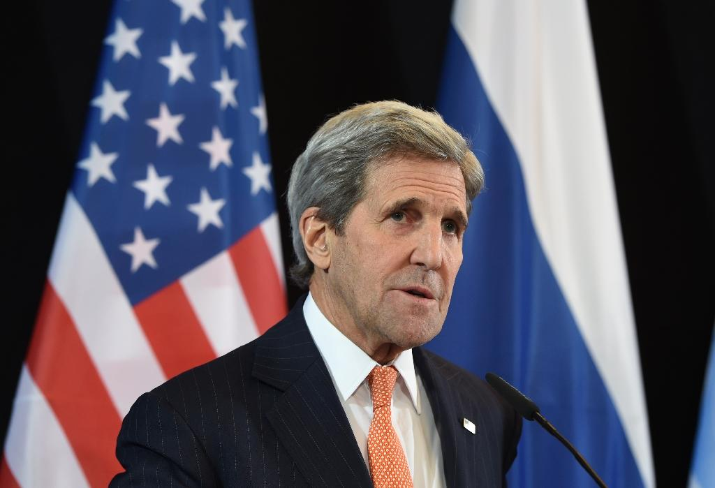Russia sanctions to remain until Ukraine deal implemented: Kerry