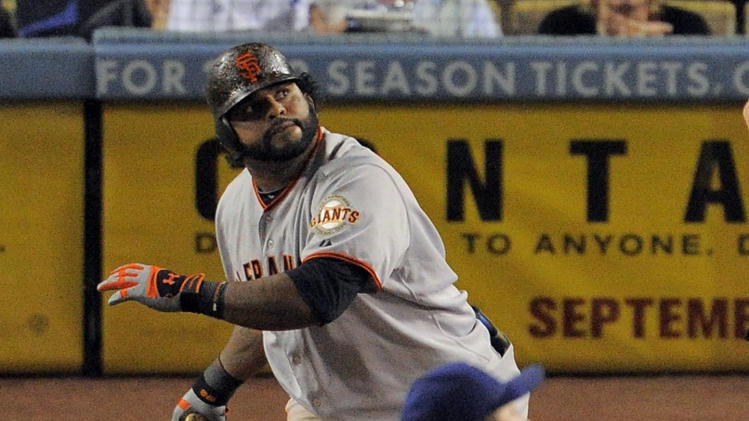San Francisco Giants' Pablo Sandoval, left, and Los Angeles Dodgers starting pitcher Hiroki Kuroda watch Sandoval's home run during the seventh inning of a baseball game, Thursday, Sept. 22, 2011, in Los Angeles. (AP Photo/Mark J. Terrill)