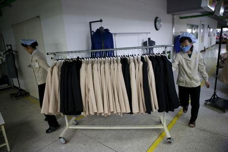 File photo of North Korean employees transporting a rack of finished products in a factory of a South Korean company at the Joint Industrial Park in Kaesong industrial zone