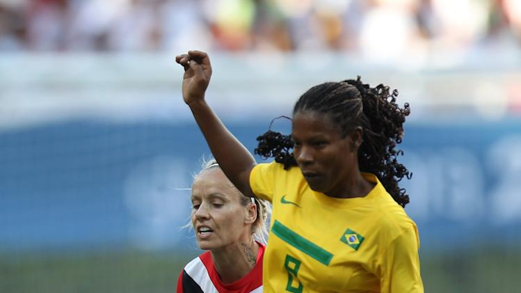 Brazil's Miraildes Mota, right, and Canada's Kelly Parker go for the ball during a women's soccer gold medal match at the Pan American Games in Guadalajara, Mexico, Thursday, Oct. 27, 2011. (AP Photo/Juan Karita)