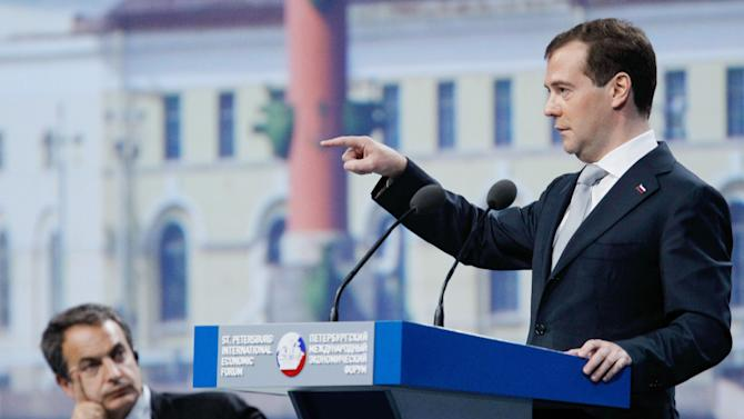 Russian President Dmitry Medvedev, right, gestures as he speaks as Spanish Prime Minister Jose Luis Rodriguez Zapatero, left, look on, during the closing session of the International Economic Forum in St. Petersburg, Russia, Saturday, June 18, 2011. (AP Photo/RIA Novosti, Dmitry Astakhov, Presidential Press Service)