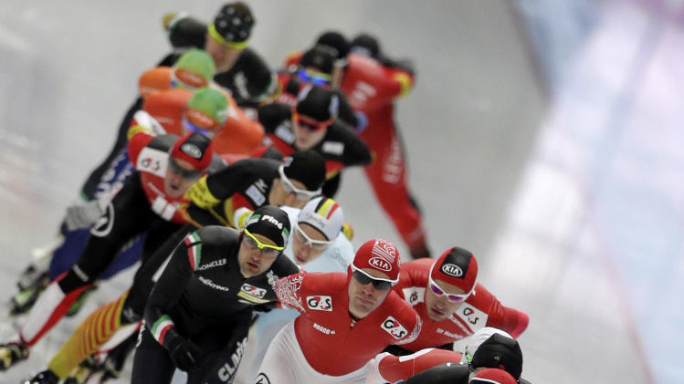 Athletes start the to men's mass start race at the speed skating World Cup in Inzell, southern Germany, Saturday, March 8, 2014. (AP Photo/Matthias Schrader)