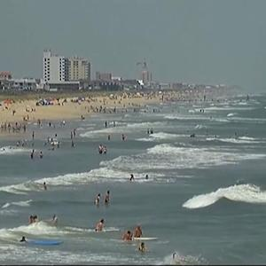 MoneyWatch: Shark attacks spur call for action in North Carolina; MasterCard to experiment with facial scans