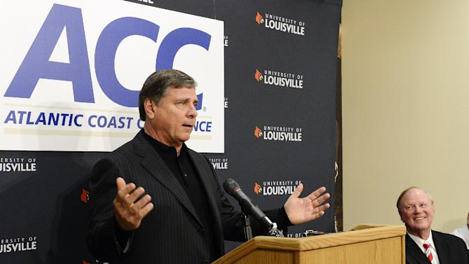 Louisville athletic director Tom Jurich, left, address reporters as President Dr. James Ramsay listens during a news conference, Wednesday, Nov. 28, 2012, in Louisville, Ky. The Atlantic Coast Conference announced Wednesday that its presidents and chancellors unanimously voted to add Louisville as the replacement for Maryland. (AP Photo/Timothy D. Easley)