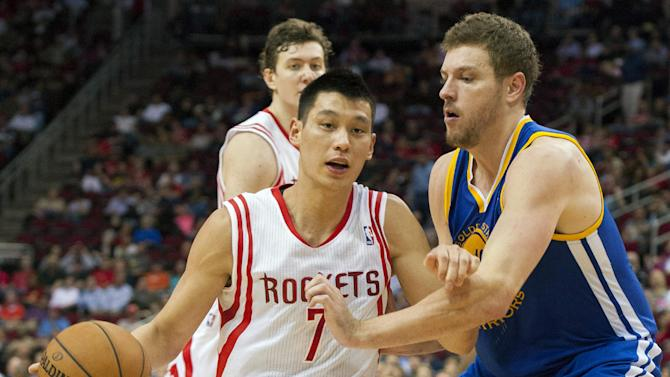 Houston Rockets' Jeremy Lin (7) drives against Golden State Warriors' David Lee, right, during the third quarter of an NBA basketball game, Tuesday, Feb. 5, 2013, in Houston. The Rockets beat the Warriors 140-109. (AP Photo/Dave Einsel)