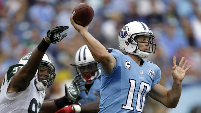 Tennessee Titans quarterback Jake Locker (10) passes as he is pressured by New York Jets outside linebacker Calvin Pace (97) in the second quarter of an NFL football game on Sunday, Sept. 29, 2013, in Nashville, Tenn. (AP Photo/Wade Payne)