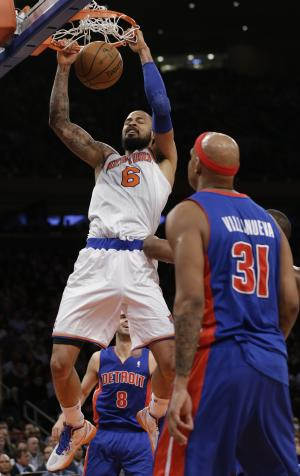 New York Knicks center Tyson Chandler (6) dunks as Detroit Pistons forward Charlie Villanueva (31) watches from the floor in the first half of an NBA basketball game at Madison Square Garden in New York, Monday, Feb. 4, 2013. (AP Photo/Kathy Willens)