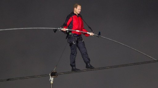 <p>Tightrope walker Nik Wallenda crosses Niagara Falls on a cable on June 15. Wallenda's walk on a cable suspended 196 feet up over a never-before-traversed rim of the biggest waterfall in North America took under 30 minutes, considerably less than expected.</p>