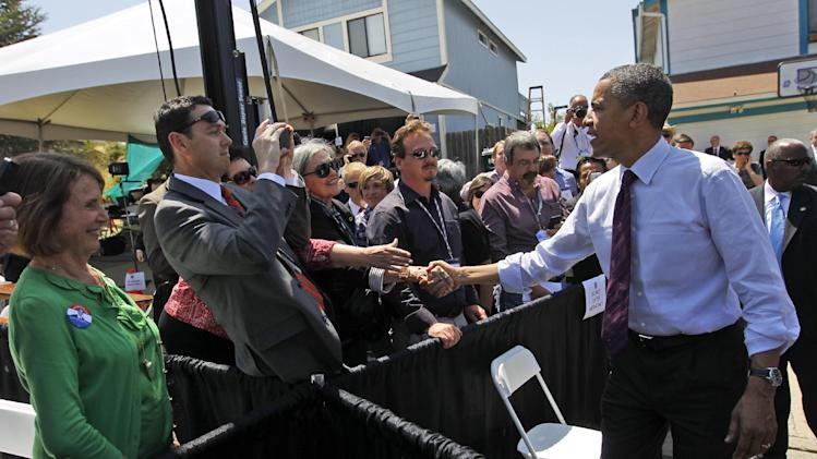 President Barack Obama greets supporters after speaking about mortgage relief, Friday, May 11, 2012, in Reno, Nev. (AP Photo/Pablo Martinez Monsivais)