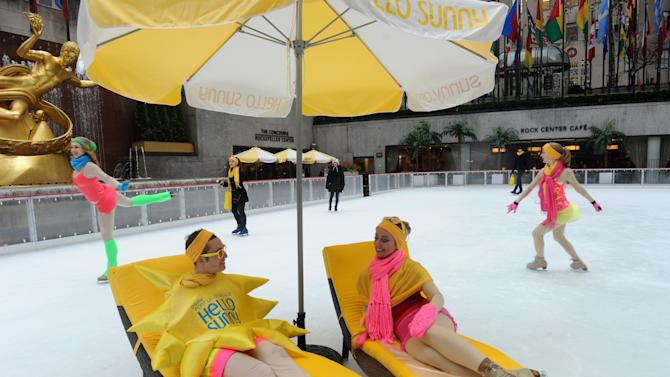 IMAGE DISTRIBUTED FOR GREATER FORT LAUDERDALE - Swimsuit clad ice skaters enjoy The Rink at Rockefeller Center as Greater Fort Lauderdale Convention & Visitors Bureau (CVB) transforms it into a tropical island paradise for the launch of CVB's new Hello Sunny campaign, Wednesday, Jan. 16, 2013, in New York.  CVB's new promotion encourages New Yorkers and the nation to enjoy the warm Greater Fort Lauderdale sunshine.  (Photo by Diane Bondareff/Invision for Greater Fort Lauderdale/AP Images)