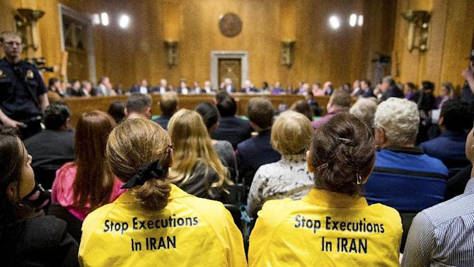 Protestors sit in the audience during a Senate Foreign Relations Committee business meeting to debate and vote on S.615, the Iran Nuclear Agreement Review Act of 2015 on Capitol Hill in Washington, Tuesday, April 14, 2015. Republican and Democrats on the Senate Foreign Relations Committee reached a compromise Tuesday on a bill that would give Congress a say on an emerging deal to curb Iran's nuclear program. (AP Photo/Andrew Harnik)