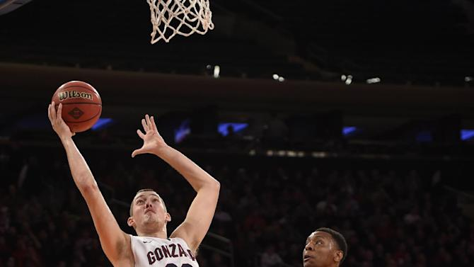 Gonzaga's forward Kyle Wiltjer (33) shoots over St. John's forward Christian Jones (4) in the first half of an NIT Season Tip-off championship NCAA college basketball game at Madison Square Garden, Friday, Nov. 28, 2014, in New York. (AP Photo/Kathy Kmonicek)