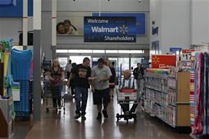 Customers shop at a Walmart Supercenter in Rogers