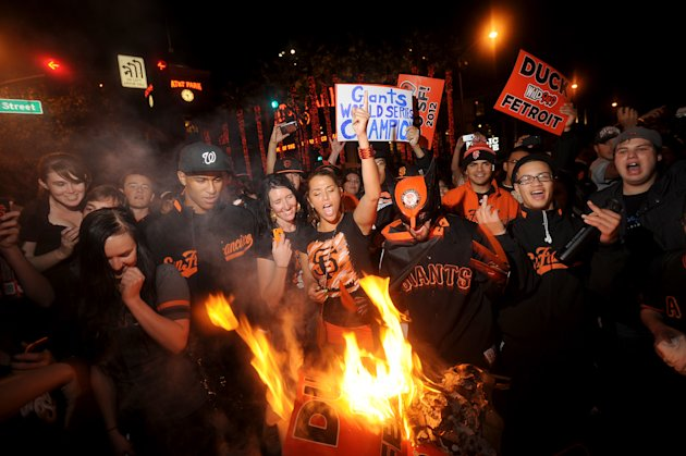 San Francisco Giants fans celebrate outside PacBell Park on Sunday, Oct. 28, 2012, in San Francisco after the Giants swept baseball&#39;s World Series against the Detroit Tigers. (AP Photo/Noah Berger)