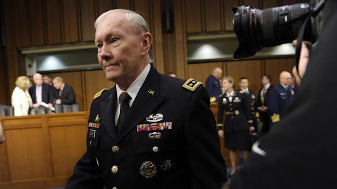 Joint Chiefs Chairman Gen. Martin Dempsey arrives on Capitol Hill in Washington, Tuesday, June 4, 2013, to to testify before the Senate Armed Services Committee hearing on pending legislation regarding sexual assaults in the military.  Determined to stop sexual assault in the military, Congress is spelling out for the services how far lawmakers are willing to go in changing the decades-old military justice system. (AP Photo/Susan Walsh)