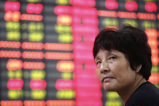 An investor sits in front of the stock price monitor at a private securities company in Shanghai, China, Wednesday Sept. 5, 2012. Weaker-than-expected U.S. manufacturing figures, just days after China announced its own production slowdown, sent Asian stock markets down Wednesday. (AP Photo)
