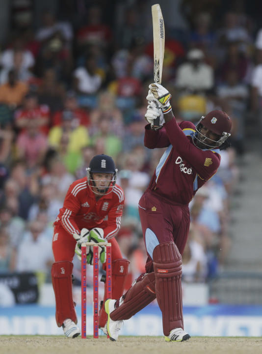 West Indies' Chris Gayle hits a six during the second T20 International cricket match against England at the Kensington Oval in Bridgetown, Barbados, Tuesday, March 11, 2014. (AP Photo/Ricardo Maz