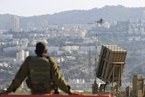 An Israeli soldier is seen next to an Iron Dome rocket …