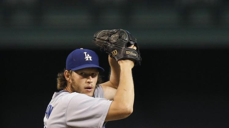 Los Angeles Dodgers' Clayton Kershaw winds up to throw a pitch against the Arizona Diamondbacks during the first inning of a baseball game Wednesday, Aug. 27, 2014, in Phoenix. (AP Photo/Ross D. Franklin)