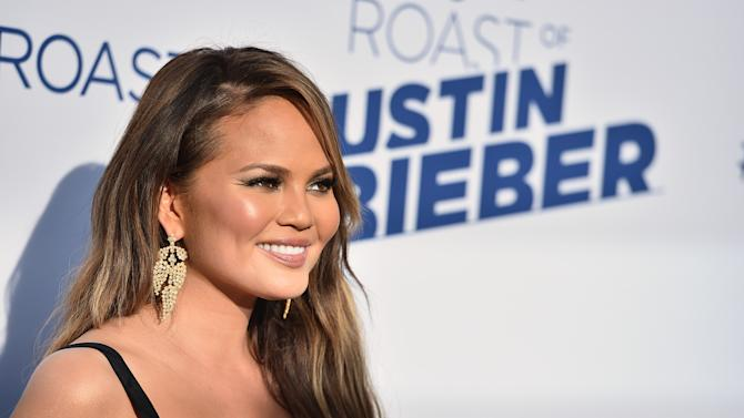 FILE - In this Saturday, March 14, 2015, file photo, Chrissy Teigen arrives at the Comedy Central Roast of Justin Bieber at Sony Pictures Studios, in Culver City, Calif. Dick Clark Productions announced Monday, March 30, 2015, that Ludacris and Teigen will host the 2015 Billboard Music Awards on May 17, from the MGM Grand Garden Arena in Las Vegas. (Photo by Jordan Strauss/Invision/AP, File)