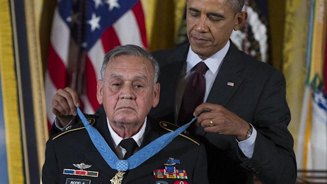 Sgt. First Class Jose Rodela is awarded the Medal of Honor by President Barack Obama during a ceremony in the East Room of the White House on Tuesday, March 18, 2014, in Washington. President Obama awarded 24 Army veterans the Medal of Honor for conspicuous gallantry in recognition of their valor during major combat operations in World War II, the Korean War and the Vietnam War. (AP Photo/ Evan Vucci)