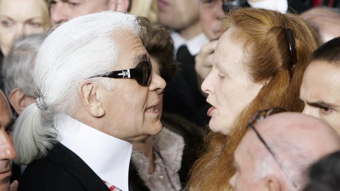 """FILE- this Jan. 23, 2007 file photo shows Vogue magazine's Grace Coddington, right, talking with German fashion designer Karl Lagerfeld after the presentation of Chanel's spring-summer 2007 Haute Couture fashion collection, designed by Lagerfeld, at the Grand Palais in Paris. Coddington is the author of a book titled, """"Grace: A Memoir,"""" released Nov. 20, 2012 by Random House. (AP Photo/Francois Mori, File)"""