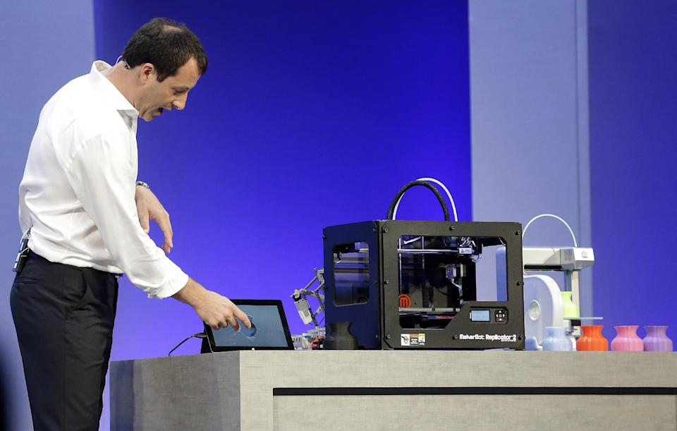 Antoine Leblond, corporate vice president of Windows Program Management, demonstrates printing from a tablet to a 3-D printer while speaking at a Microsoft event in San Francisco, Wednesday, June 26, 2013. (AP Photo/Jeff Chiu)