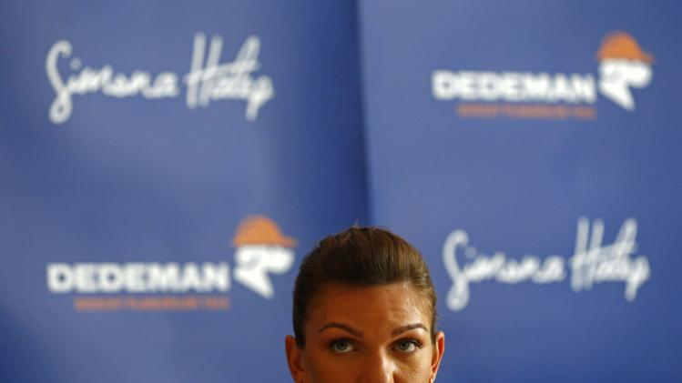 Romanian tennis player Halep attends a news conference in Bucharest