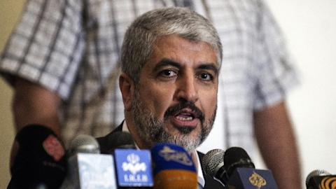 Hamas political leader Khaled Meshaal speaks at political conference on Palestine on April 4, 2013 in Cairo