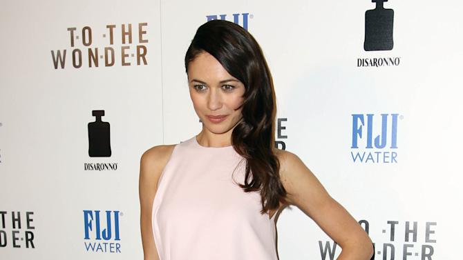 """Actress Olga Kurylenko arrives at the premiere of """"To The Wonder"""" hosted by FIJI Water on Tuesday, April 9, 2013 in Los Angeles. (Photo by Matt Sayles/Invision for Fiji Water/AP Images)"""
