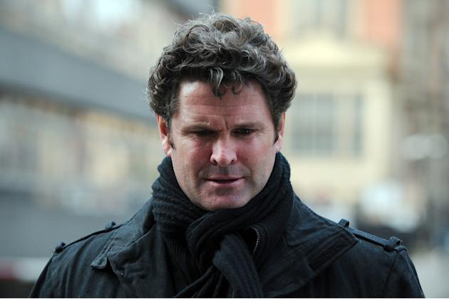 Former New Zealand cricketer, Chris Cairns, returns to the High Court in central London on March 05, 2012, after a lunch break in a hearing in a libel case he has brought against ex-chairman of India'