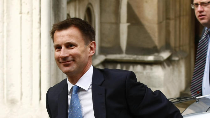 Britain's government culture secretary Jeremy Hunt arrives at the High Court to give evidence at the Leveson Inquiry, London, Thursday, May 31, 2012.  The Leveson inquiry is Britain's media ethics probe that was set up in the wake of the scandal over phone hacking at Rupert Murdoch's News of the World newspaper, which was shut in July 2011, after it became clear that the tabloid had systematically broken the law. (AP Photo/Tim Hales)