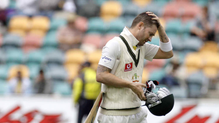 Australian captain Michael Clrake leaves the field after having been caught by New Zealand captain Ross Taylor off the bowling of Doug Bracewell during Australia's second innings in the fourth day of play in the second test match in Hobart, Australia, Monday, Dec. 12, 2011. (AP Photo/Chris Crerar)