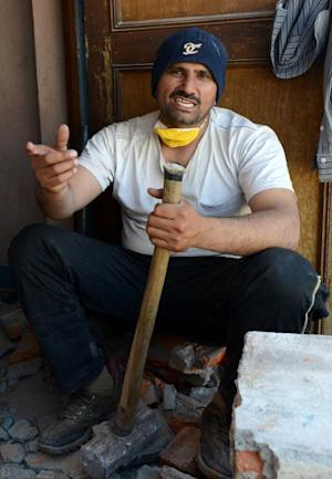 Pakistani refugee Nawid Ahmad, pictured at a construction …