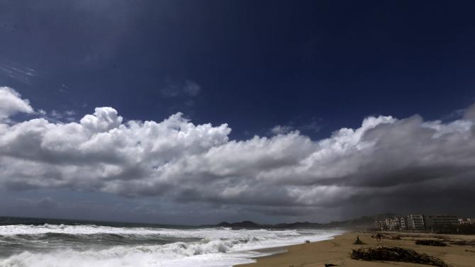 Clouds move in before the possible arrival of Tropical Storm Polo in San Jose del Cabo, after Hurricane Odile hit Baja California