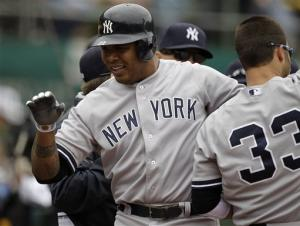 Kuroda throws 8 scoreless as Yankees beat A's 2-0
