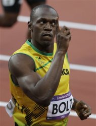 Jamaica's Usain Bolt reacts after a men's 100m semifinal heat during the athletics in the Olympic Stadium at the 2012 Summer Olympics, London, Sunday, Aug. 5, 2012. (AP Photo/Matt Slocum)
