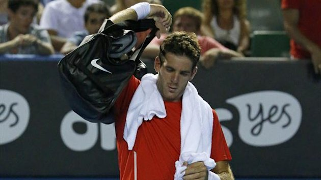 Juan Martin Del Potro of Argentina leaves the court for a break at the end of the fourth set during his men's singles match against Roberto Bautista Agut of Spain at the Australian Open 2014 tennis tournament in Melbourne January 17, 2014. (Reuters)