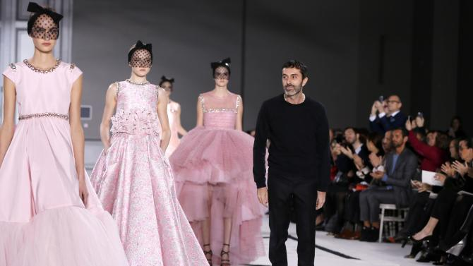 Italian designer Giambattista Valli appears at the end of his Haute Couture Spring Summer 2015 fashion show in Paris