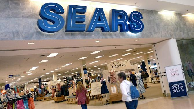 FILE - In this Monday, May 14, 2012, file photo, shoppers walk into Sears in Peabody, Mass. Sears Holdings Corp. said Friday, Dec. 6, 2013, that it will spin off its Lands' End clothing business as a separate company by distributing stock to the retailer's shareholders. (AP Photo/Elise Amendola, File)