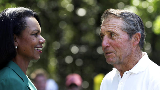 Gary Player speaks with former Secretary of State Condoleezza Rice during the par three competition before the Masters golf tournament Wednesday, April 10, 2013, in Augusta, Ga. (AP Photo/David J. Phillip)