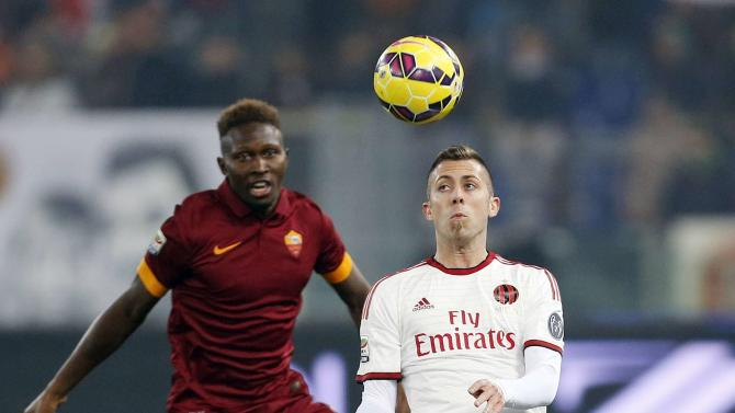 AS Roma's Yanga-Mbiwa challenges AC Milan's Menez during their Italian Serie A soccer match in Rome