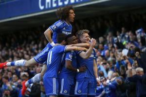 Chelsea's Schurrle celebrates with team mates after scoring a goal against Arsenal during their English Premier League soccer match at Stamford Bridge in London