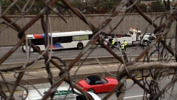 1 killed, another trapped under bus after crash