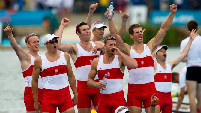 Canada's men's eight rowing team members celebrate their silver medal at Eton Dorney