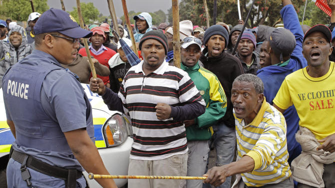 South African police arrest 50 in farm protest