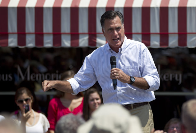 Republican presidential candidate, former Massachusetts Gov. Mitt Romney gestures during a campaign stop at Sweetie-licious Bakery on Tuesday, June 19, 2012 in DeWitt, Mich. (AP Photo/Evan Vucci)