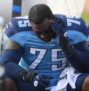 Tennessee Titans defensive tackle Jovan Haye sits on the bench during the final minutes of the NFL football game against the Miami Dolphins in Miami, Sunday, Nov. 14, 2010. The Dolphins won 29-17. (AP Photo/Alan Diaz)